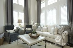 A Sleek and Sophisticated Living Room Decor by A Well Dressed Home, LLC. To see more designs, please go here: http://awelldressedhome.com/portfolio/miller-living-room-3/