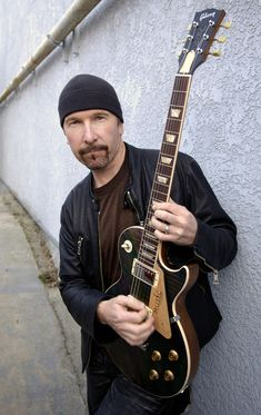 The Edge (U2) - Yes, I gotta a crush on The Edge from U2... I think he is handsome and he can play the hell out of a guitar!