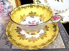 GROSVENOR TEA CUP AND SAUCER YELLOW & FLORAL GOLD GILT TEACUP PATTERN