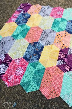 Jaybird Quilts: True Colors by Free Spirit Jaybird Quilts, Scrappy Quilts, Quilting Fabric, Quilting Projects, Quilting Designs, Quilt Corners, Charm Pack Quilts, Hexagon Quilt, Traditional Quilts