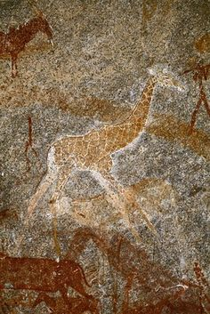 """This giraffe, modeled in yellow and white, was created with particular detail and skill. One of the leading experts on African rock art, Peter Garlake, has called it the finest animal painting in the country."" - photo by David Coulson, via The Wall Street Journal (1/25/10);  in the Inanke Cave in southern Zimbabwe"