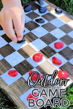 Make a fun double sided outdoor game board complete with game pieces! Learn how to make a set for your outdoor space, these make great gifts too! #game #boardgame #diy #woodworking #craft #kidscraft