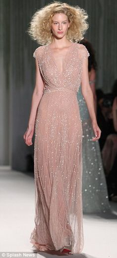 Jenny Packham, who is celebrating her 25th year of designing intricate eveningwear, continued to provide a catwalk full of glittering, red c...
