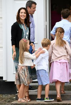 Princess Josephine goes to put her hands on her twin brother's shoulders as the family make their way back inside