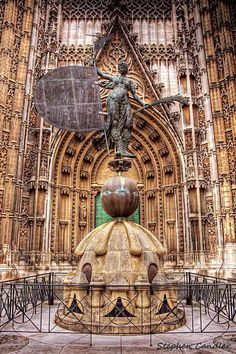 Statue at the Cathedral entrance, Seville, Spain