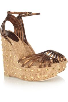 Gold-studded cork heel measures approximately 140mm/ 5.5 inches with a 40mm/ 1.5 inch platform Bronze leather Almond toe Buckle-fastening ankle strap
