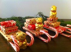 great crafty gift idea,  Wrap different sized sweets and chocolates to create a Santa sleigh.