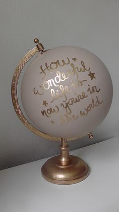 Hand painted globe with song lyrics. por WholeWorldOfLove en Etsy
