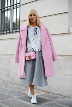 Pin for Later: 50 Outfits That Prove 2014 Was Officially the Year of Sneakers  A full midiskirt and feminine outfit gets a tomboy twist thanks to these white trainers.