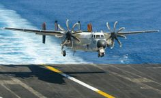 C-2A Greyhound assigned to Fleet Logistics Support Squadron (VRC) 40 makes an arrested landing aboard the Nimitz-class aircraft carrier USS Carl Vinson.