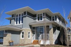 Prairie with generous eaves typical of its style www.cooperscrossing.ca  #coopersairdrie #architecture