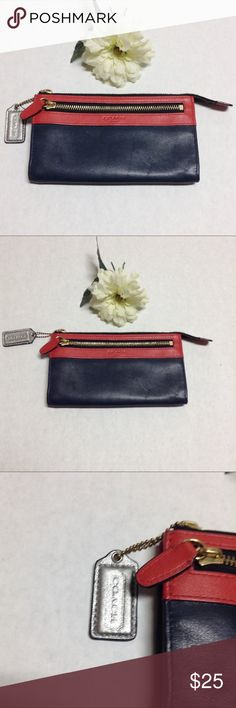 """Coach Leather navy and red colorblock wallet Coach Leather navy and red colorblock wallet. Zipper side and top. Does not have wristle strap still a beautiful functional wallet. Very little wear extremely soft leather. Measurements: height: 4.5"""" depth: 1"""" length: 7.75"""" Coach Accessories"""