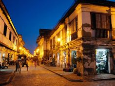 Calle Crisologo, Vigan  Photograph by Laurie Noble/Getty Images    Streetlamps illuminate historic Calle Crisologo in the 16th-century town of Vigan. Located in the province of Ilocos Sur, Vigan's well-preserved mix of Spanish colonial planning and Asian architectural influences earned it a spot on UNESCO's World Heritage list in 1999.