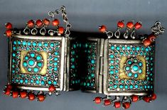 Uzbekistan | Silver gilt cuffs with inlaid turquioise and coral fringe. ca. Late 19th century |  © Linda Pastorino