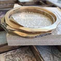 """🆕C+I   Geovista Pavé Bangle Set ••Part of my C+I sample sale••  Arm yourself with this modern + cool set of antique gold-plated bangles. Pairing geometric angles with sparkling crystal pavé accents, style this dynamic duo together, one-by-one, or layer 'em on with your other favorite bracelets! ✨This set is brand new + in flawless, unused condition   nickel-free   2.5"""" approx. inner diameter   clear crystal pavé Chloe + Isabel Jewelry Bracelets"""