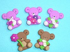 5 cute bears  Greeting Card making embellishments / toppers  made from Polymer Clay (Fimo)  bears are approx 2.5cm tall  Bears are flat backed and suitable for decorating your handmade greeting cards, gift tags and crafts.   (not suitable for small children)  Postage & Packaging order as many items as you like from me in one transaction and just pay  the one price per parcel.     UK orders:  £3.00                  Worldwide orders:  £4.50