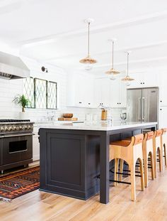 One thing is for sure: You love Amber Lewis's boho Californian vibe (we do too)! Quite a few images of her work made their way into the top pins, including this stunning blue-and-white kitchen,...