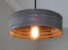 What a great light!Made with a grey corrugated metal that looks just like it...