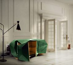 With the style of a precious jewel, the new DIAMOND sideboard, colored in green emerald, will make a splash in interior design as it is one of the hottest color trends of the year. Created by Boca do Lobo. #workshoptonic #design