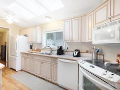 Property 4714 Muir Road Unit Courtenay, has 2 bedrooms, 2 bathrooms with 938 square feet. Living Room Plan, Living Room Kitchen, Insulating A Shed, Office Names, Remodeling Mobile Homes, Room Planning, Walk In Shower, Laminate Flooring, Kitchen Cabinets