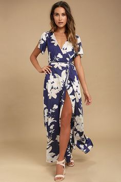 You'll feel like royalty among the roses in the Azalea Regalia Navy Blue Floral Print Wrap Maxi Dress! Navy blue, white, and peach floral print decorates this woven wrap dress with a plunging neckline, fluttering short sleeves, and an open back. Breezy maxi skirt has internal ties and a waist sash.