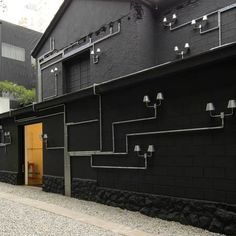 interesting wall deco/ fixture : Pipe Light: Lighting installation for outdoors and indoors from Triptyque