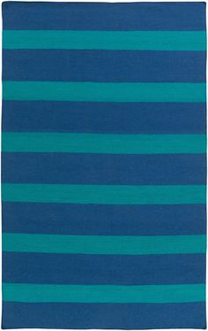 This navy blue and teal rug in a wide stripes is one of our new favorites for luxury homes to help create an outdoor entertaining space.