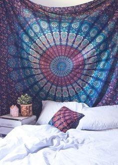 Top off your bed or accent a wall with this unique boho tapestry, featuring a colorful mesmerizing kaleidoscope-like mandala pattern. This tapestry also doubles as a picnic blanket, perfect for festiv