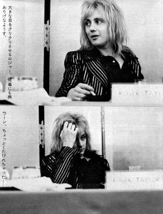 Roger shown doing a live interview with his band mates for a massive press in Japan while Queen was in the country for a concert tour.