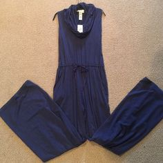 Dark blue one piece romper. NWT dark blue long romper. Drawstring waist with pockets. Wide leg at the bottom. Cowl neck and super soft. No trades. Max Studio Other