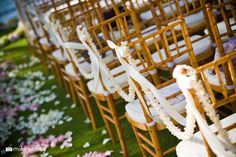 String of Orchids as Chair Decor  www.mikesidney.com    The Wedding Lady - Exquisite Wedding Planning in Maui Hawaii and Vancouver BC    #weddinglady.com