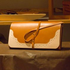 handcrafted clutch bag as wingtip point
