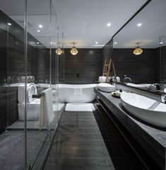 23 Pictures Of The Ripple Hotel At Qiandao Lake, In Hangzhou, China // Luxurious dark gray and white bathroom suite.