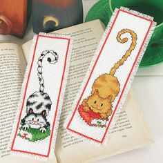 "Smart Cats Bookmarks  SMART CAT BOOKMARKS, quick to counted cross stitch, fun for all to use, even children. Kit makes both designs and includes 14-count white Aida cloth, cotton floss, needle, chart and instructions. Each, approx. 2 1/2"" x 8"". Imported from Belgium. A Stitchery exclusive!	      ****   Smart Cats Bookmarks  Item #: T10530  Price: $18.99"