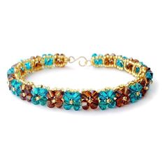 """Swarovski crystal woven bracelet in """"blue zircon"""" and """"smoked topaz."""" Available in my Etsy shop: [link] Turquoise and Brown Bracelet Beaded Bracelet Patterns, Jewelry Patterns, Seed Bead Bracelets, Bangle Bracelets, Seed Beads, Crystal Jewelry, Beaded Jewelry, Bracelet Making, Jewelry Making"""