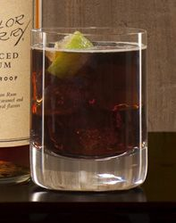 2 parts Sailor Jerry  Cola    Glass: highball    Method:  Build in glass over cubed ice & garnish with lime wedge