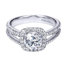 14k white gold 1.55cttw split-shank french pave set round diamond engagement ring with cushion shaped halo. This 1/2cttw mounting features a cushion shaped halo of round diamonds with a french pave se