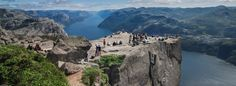 Preikestolen at Lysefjorden Stavanger is one of Norway's major tourist magnets. 250 000 people heading out on the breathtaking mountain plateau every year.