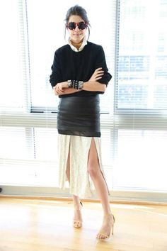 How to Layer a Skirt Over Pants or a Dress - layering pro Leandra Medine of 'The Man Repeller' rocking a leather mini skirt layered over a double slit midi skirt—amazing!