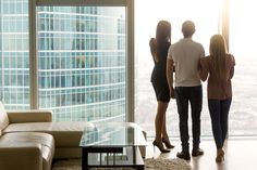 rear view of three business people standing by the full length floor-to-ceiling window in office looking at big city scenery. real estate agent showing apartment to couple enjoying birds-eye view Buying A Condo, Modern Condo, Take The Stairs, New Condo, Real Estate Tips, Downtown Los Angeles, Condos For Sale, Luxury Apartments, Beautiful Interiors