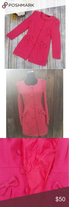 "🎉Hot Pink Polyester Bow Peacoat🎉 Unique color, and design, this peacoat will not only keep you warm, but it will keep you looking stylish! Beautiful hot pink color Bow detail in front Inside lined with more hot pink 4 buttons Size S In great condition  Bust 34"" Sleeve 23"" Length 30"" Jackets & Coats"