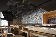 Taiwan Noodle House by Golucci International Design Beijing  Wall covered in bowls and ceiling in chop sticks