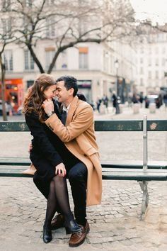 Image by Andreea Alexandroni Photography - A Romantic Engagement Shoot in Paris the City of Love. Captured by Andreea Alexandroni Photography with Bride & Groom to-be wearing stylish camel coat & hat.