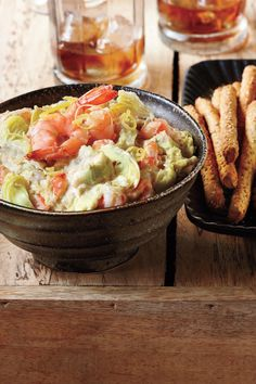 Warm Artichoke-Shrimp Dip - Super Dips for Bowl Games - Southernliving. Recipe:Warm Artichoke-Shrimp Dip  Dip pita crackers and breadsticks in our version of this creamy, garlicky favorite. Serve half of the dip first, keeping the remaining half warm in saucepan.
