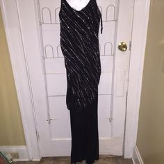 Sparkly Pant Suit Was my mothers. Sparkles black top with black pants. Good for any kind of fancy or formal event. Size large from teenie weenie. Teenie Weenie Tops