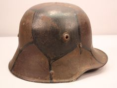 Army WWI M17 Cammo Helmet. Camouflage of the WWI era was not used to become invisible. It was used to deceive the eye, and make it much more difficult to predict the distance of an object such as a boat, or a soldier.   source: http://militarycollectiblesinc.com/catalog/product_info.php?cPath=7_104&products_id=5084&osCsid=d2c41470f6cbaf88c1feef2e7722c0c5
