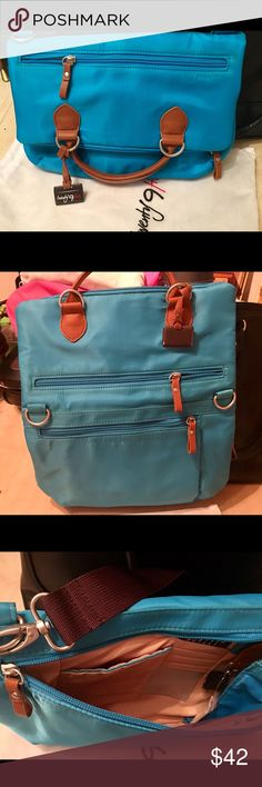 Twenty9Five Purse Brand New!! Beautiful color Blue! Can be worn as cross-body or hand straps. When flap is up and opened you can fit small laptop or tablet. There is access in the bag from center zipper and the additional zipper opens to wallet style with lots of room and credit card slots. twenty9five Bags Crossbody Bags