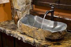 One Of A Kind Stone Sink With Waterfall Faucet