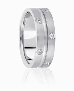 A Carved Center Channel Is High Polished Then Enclosed By Flush Set Diamond Edges In this Adventerous Wedding Ring