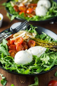A zesty bed of arugula topped with roasted asparagus, onions, sweet grape tomatoes, and rich, creamy burrata cheese. An easy, vegetarian meal.